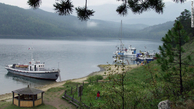 Tourists boats moored on the shore of Lake Baikal, Russia.