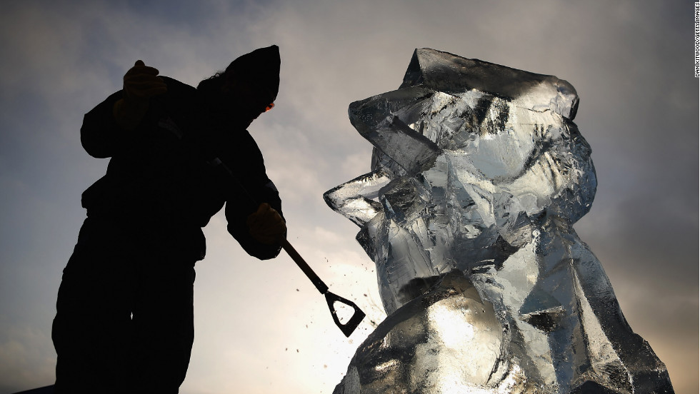 A contestant works on an ice sculpture at The London Ice Sculpting Festival at Canary Wharf on Friday, January 11 in London. Ice and snow festivals are taking place all around the world, showcasing creative ways to enjoy the cold weather.