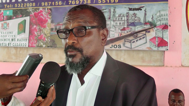 Mohamed Abdi Hassan speaks to journalists on January 10 in the central Somali region of Adado after announcing his retirement.