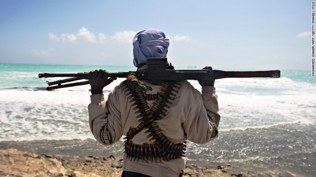 Photo made on January 7, 2010 shows an armed pirate keeping vigil along the coastline at Hobyo town, northeastern Somalia near where Greek cargo ship, MV Filitsa, is anchored since its capture by pirates November 10, 2009. A six-nation east African regional bloc on February 1, 2010 urged Somalia's two breakaway regions of Puntland and Somaliland to jointly battle Islamist militia which it said had extended to the areas