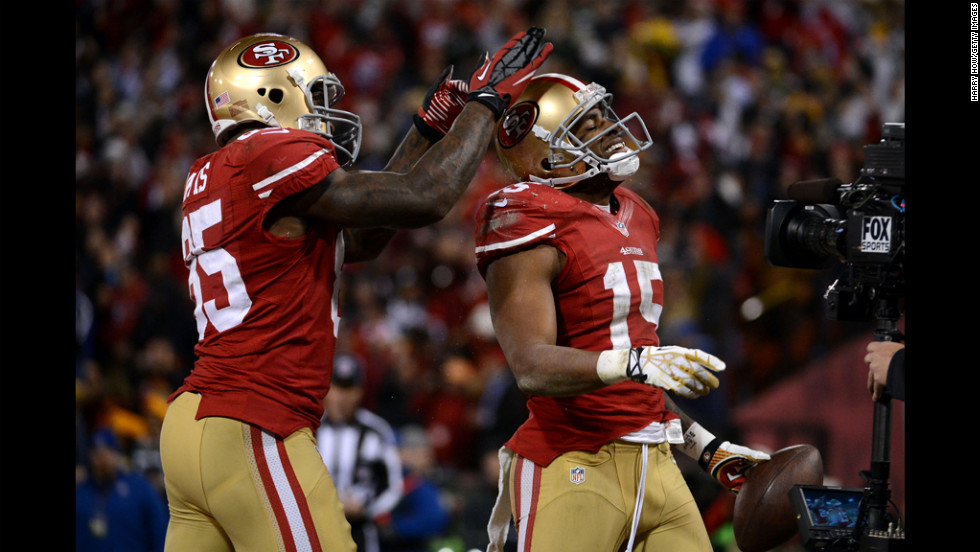 Tight end Vernon Davis celebrates with Crabtree of after scoring a touchdown for the 49ers in the second quarter.