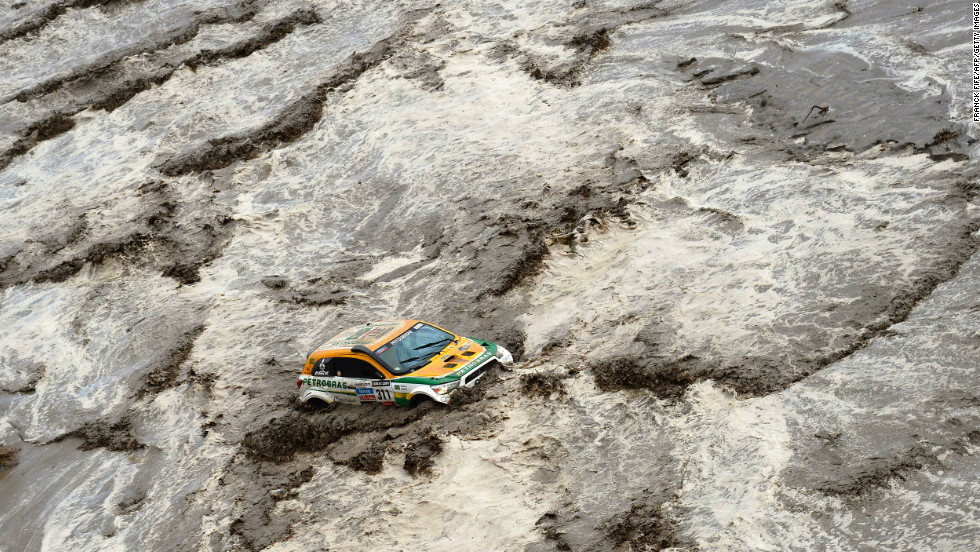 Brazil's Guilherme Spinelli gets stuck in a flooded river during the eighth stage of the rally on January 12.