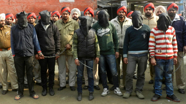 Indian police with six men accused of a gang rape in Punjab state, for an appearance at court in Gurdaspur on January 13, 2013.