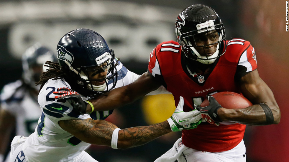 Falcons receiver Julio Jones tries to avoid the tackle of Earl Thomas of the Seahawks on Sunday.