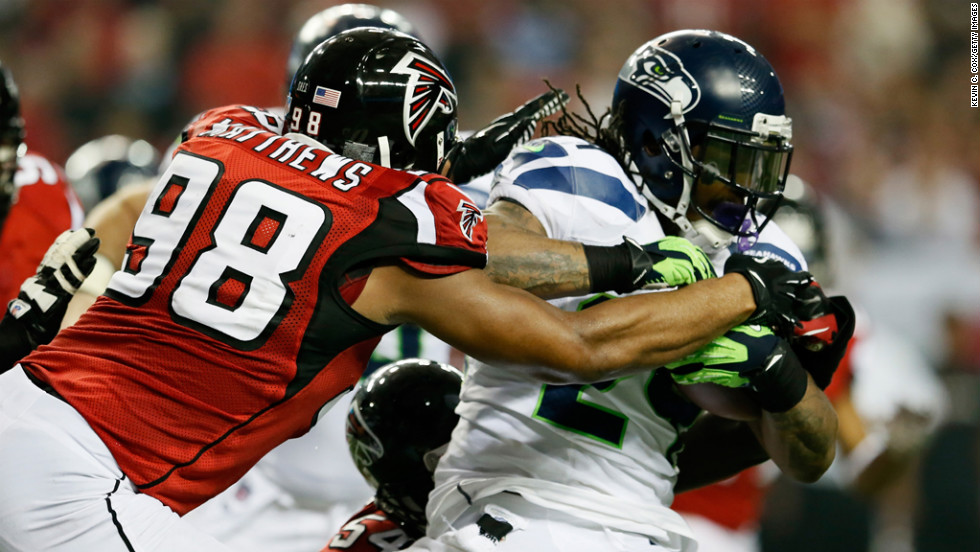 Cliff Matthews of the Falcons tackles Marshawn Lynch of the Seahawks on Sunday.
