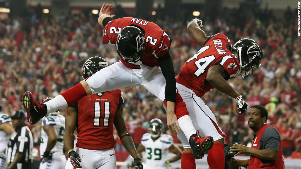 Matt Ryan and Jason Snelling of the Falcons celebrate a touchdown against the Seahawks on Sunday.