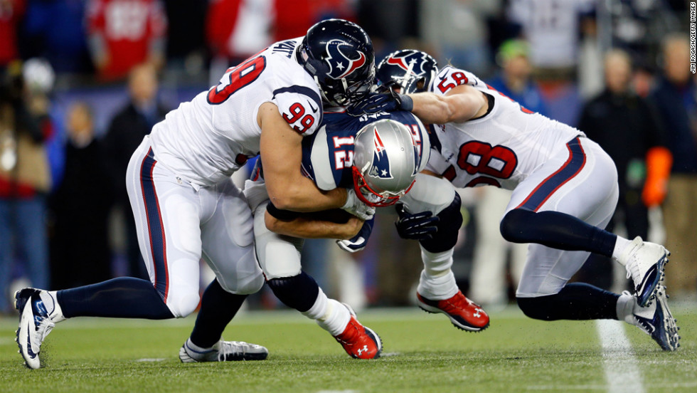 Texans players J.J. Watt, left, and Brooks Reed sack Patriots quarterback Tom Brady on Sunday.
