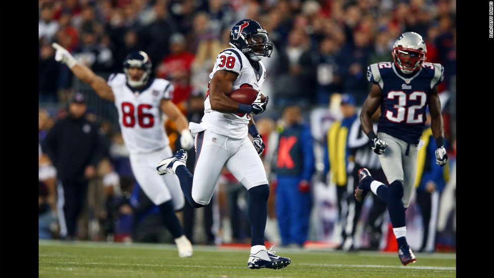Danieal Manning of the Texans returns the opening kickoff for 94 yards against Devin McCourty of the Patriots on Sunday.