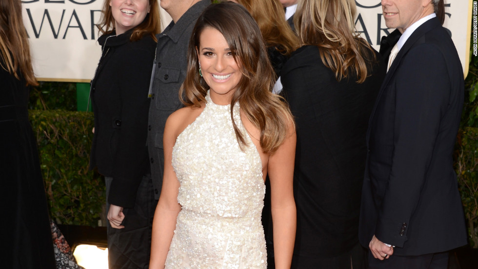 Lea Michele put a new twist on Jolie's iconic pose by showcasing her left leg on the red carpet.