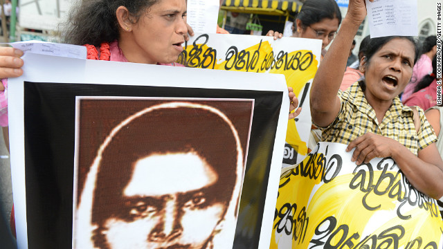 Activists hold up a portrait of Rizana Nafeek, following her execution by Saudi authorities, Colombo, January 11, 2013.