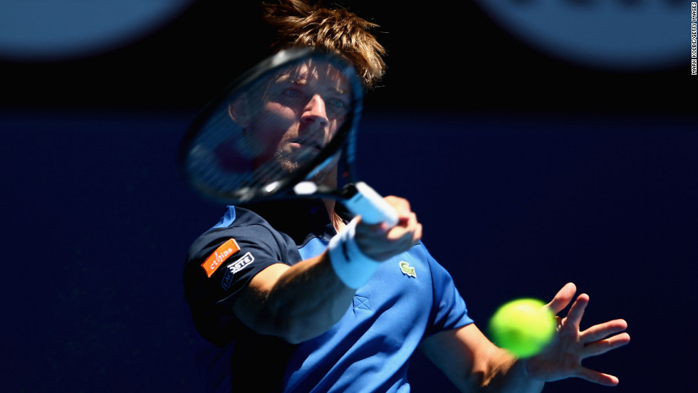 David Goffin of Belgium plays a forehand in his first-round match against Fernando Verdasco of Spain on January 14. Verdasco defeated Goffin 6-3 3-6 4-6 6-3 6-4.