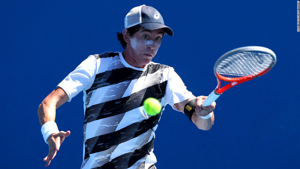 John-Patrick Smith of Australia plays a forehand on January 15 during his first-round match against Joao Sousa of Portugal. Sousa defeated Smith 6-4, 6-1, 6-4.