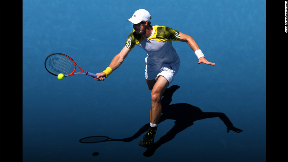 Great Britain's Andy Murray plays a forehand against Robin Haase of the Netherlands on Day 2 of the Australian Open. Murray defeated Haase 6-3, 6-1, 6-3. Murray won 6-3 6-1 6-3.