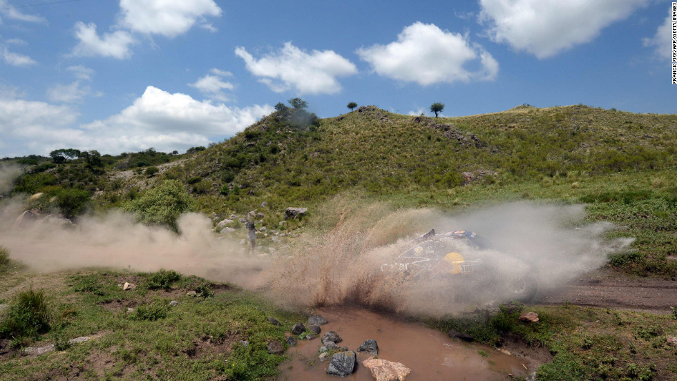 Qatar's Nasser Al-Attiyah steers his buggy through muddy water on January 14.