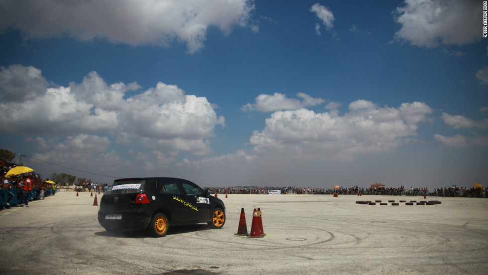 Marah Zahalka taking a turn during a race in Bethlehem. Palestinian street car races, held at makeshift venues such as airfields, often attract 1,000 spectators.