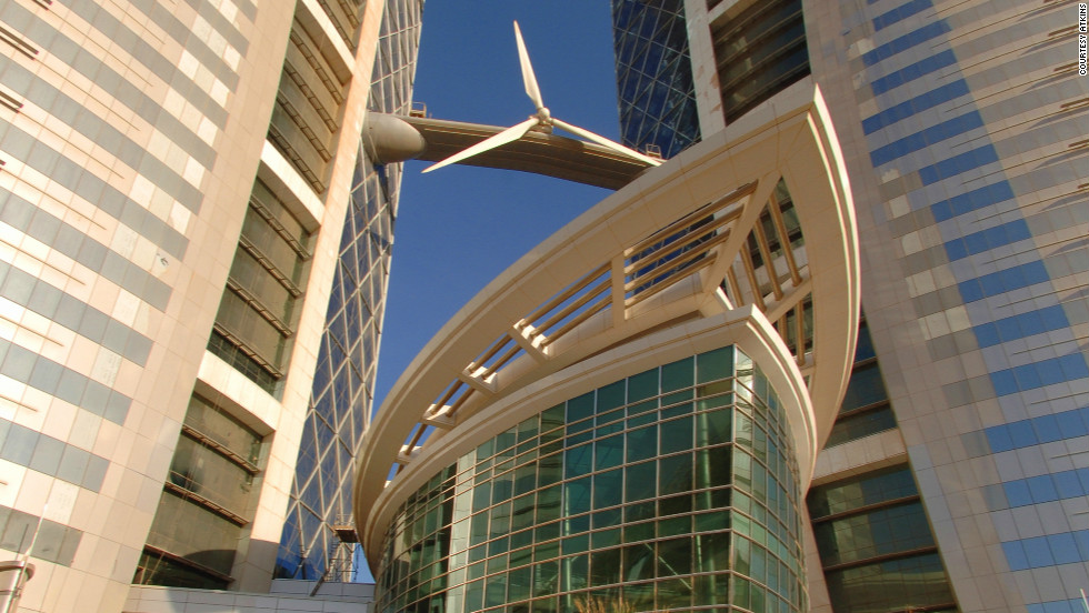 """<a href=""""http://www.bahrainwtc.com/"""" target=""""_blank"""">The Bahrain World Trade Center</a>, built in 2008, is 50 floors high, and,  uniquely, giant wind tubines connect the building's two towers. The turbines generate for 11-15% of the power required by the building when fully operational, according to architect <a href=""""http://www.atkinsglobal.com/"""" target=""""_blank"""">Atkins</a>."""