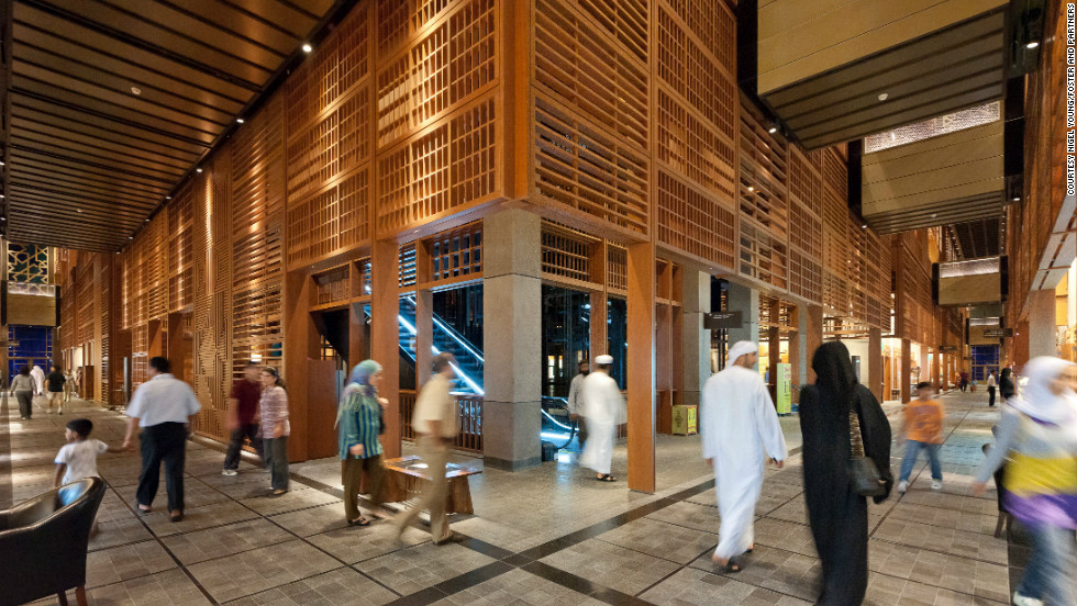 This photo shows shoppers browsing Abu Dhabi's rebuilt central market -- ventilation in the market is controlled by sliding roofs and walls.