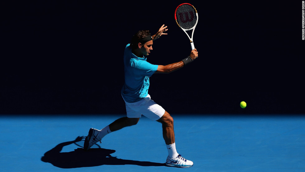 Roger Federer of Switzerland plays a backhand in his first-round match against Benoit Paire of France during Day 2 of the 2013 Australian Open in Melbourne on Tuesday, January 15. Federer defeated Paire 6-2, 6-4, 6-1.
