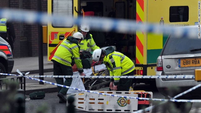 Members of the emergency services load equipment into an ambulance near the scene of a helicopter crash in central London on January 16, 2013.