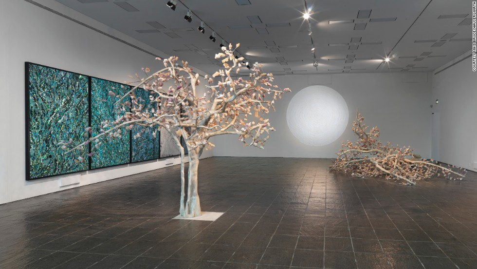 "Kher admits to being inspired by the macabre and loves the idea of combining it with traditional beauty. In her ""Solarum Series""<em> </em>(2007), her trees have autumnal leaves, which upon closer inspection are sculpted animal heads."