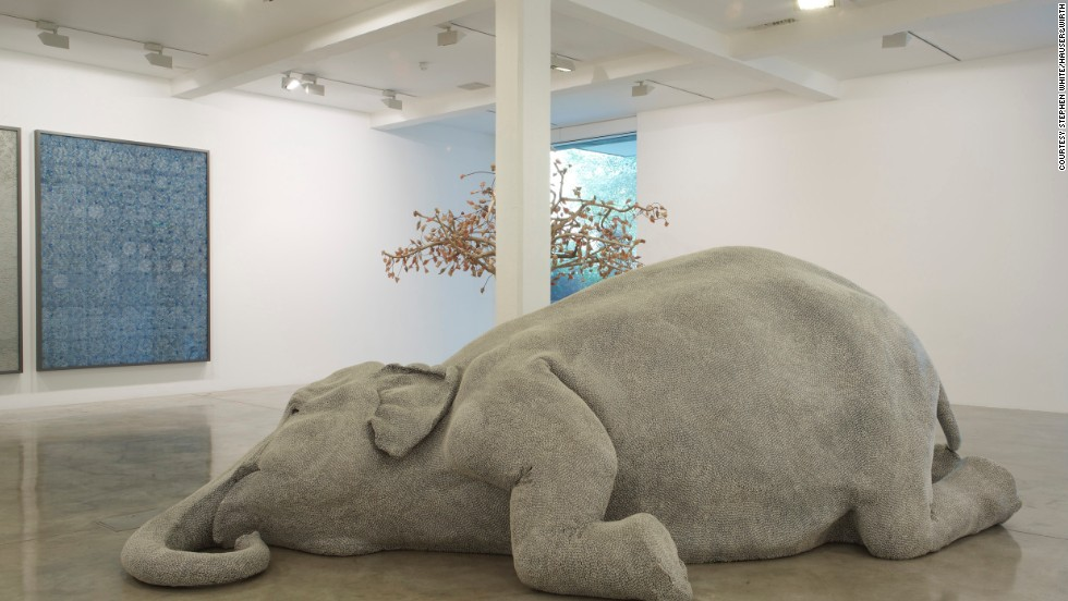 "In 2006, Kher became an internationally recognized artist after exhibiting her life-size sculpture of an elephant entitled ""The Skin Speaks a Language Not It's Own."""