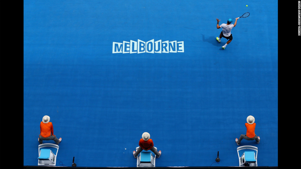 Bernard Tomic of Australia plays a forehand in his second-round match against Daniel Brands of Germany during Day Four of the 2013 Australian Open on January 17. Tomic narrowly defeated Brands 6-7 (4), 7-5, 7-6 (3), 7-6 (8).