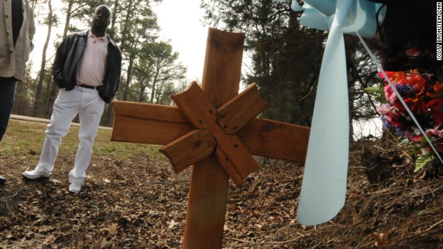 Donny Butts stands on a Mississippi roadside where his father was hit and killed by a white teen driver.