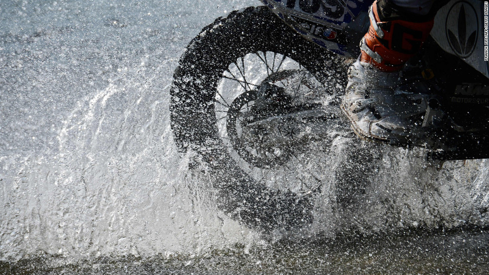 A biker splashes through Stage 10 on January 15.