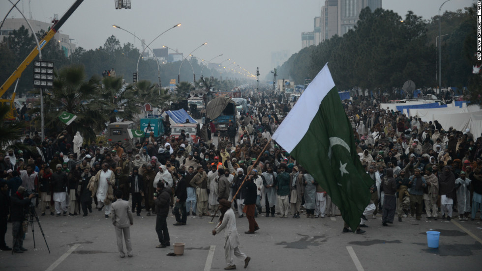 Supporters of Tahir-ul Qadri gather on the fourth day of protests in Islamabad early on January 17.