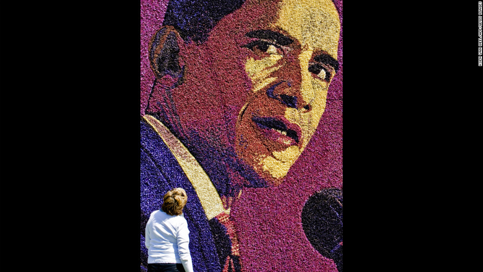 HOLLAND: A Dutch woman looks at a flower mosaic featuring Obama in Limmen, on May 12, 2009.