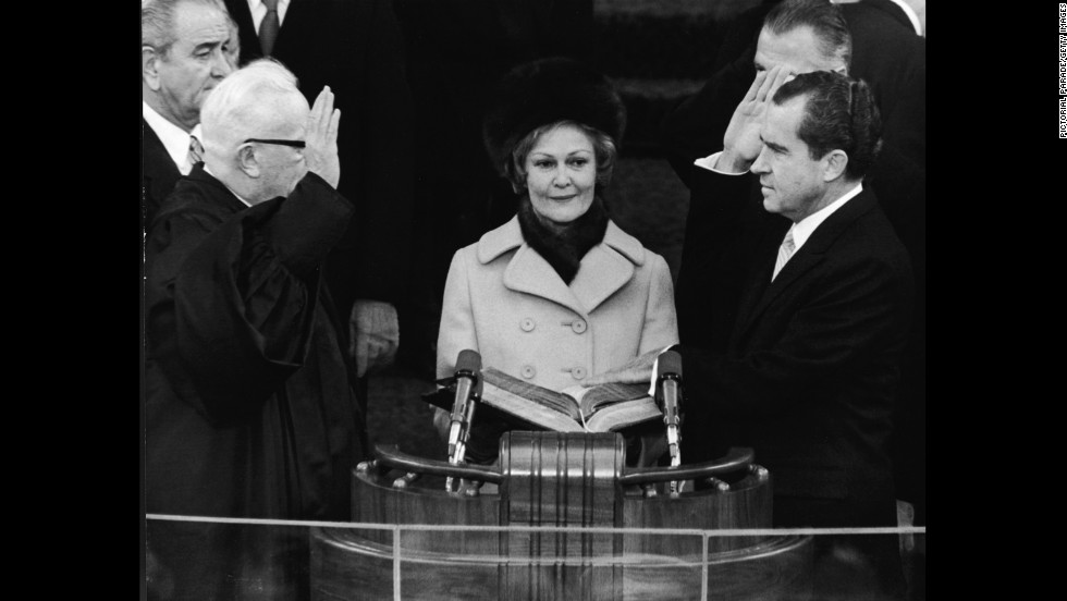 Richard Nixon takes the oath of office as he is sworn in as the 37th president of the United States on January 20, 1969.
