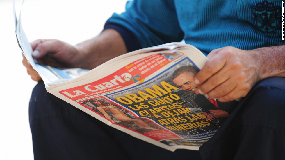 CHILE: A man reads a Santiago newspaper featuring Obama's inauguration on January 21, 2009.