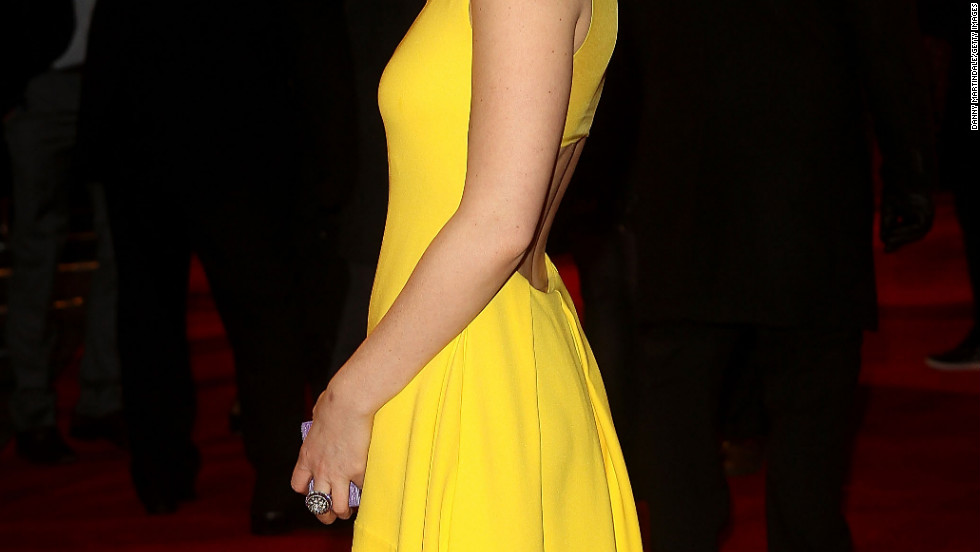 Kate Mara poses on a red carpet in London.