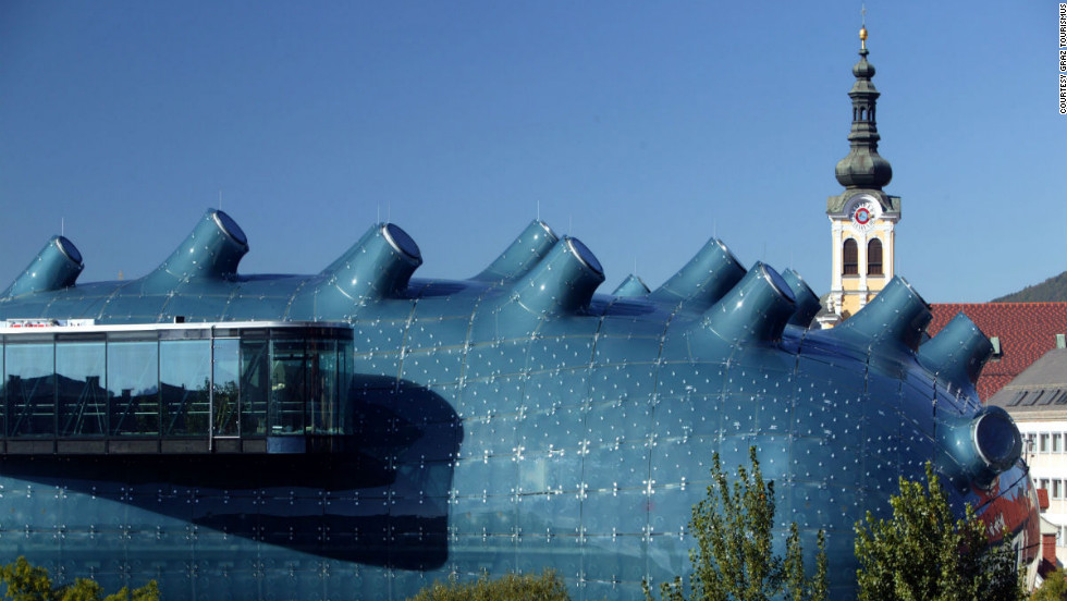 "Designed in 2003 to commemorate Graz's year as the European Capital of Culture, <a href=""http://www.museum-joanneum.at/en/kunsthaus "" target=""_blank"">Kunsthaus Graz</a> has since become synonymous with the forward-thinking city itself. <br /><br />British architects Colin Fournier and Peter Cook built a distinctive structure to represent the city's role as a center for contemporary art since the 1960s. <br /><br />The sizable complex (11,100 square meters/120,000 square feet) is affectionately known as the ""friendly alien"" by locals for its nozzles and snouts. Most surprising is the way it can change with each new exhibition -- both exterior and interior can be altered according to a curator's whim."