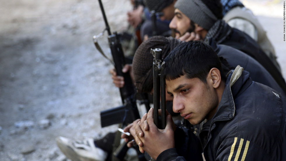 Free Syrian Army fighters rest in Mleha suburb in Damascus on January 17.