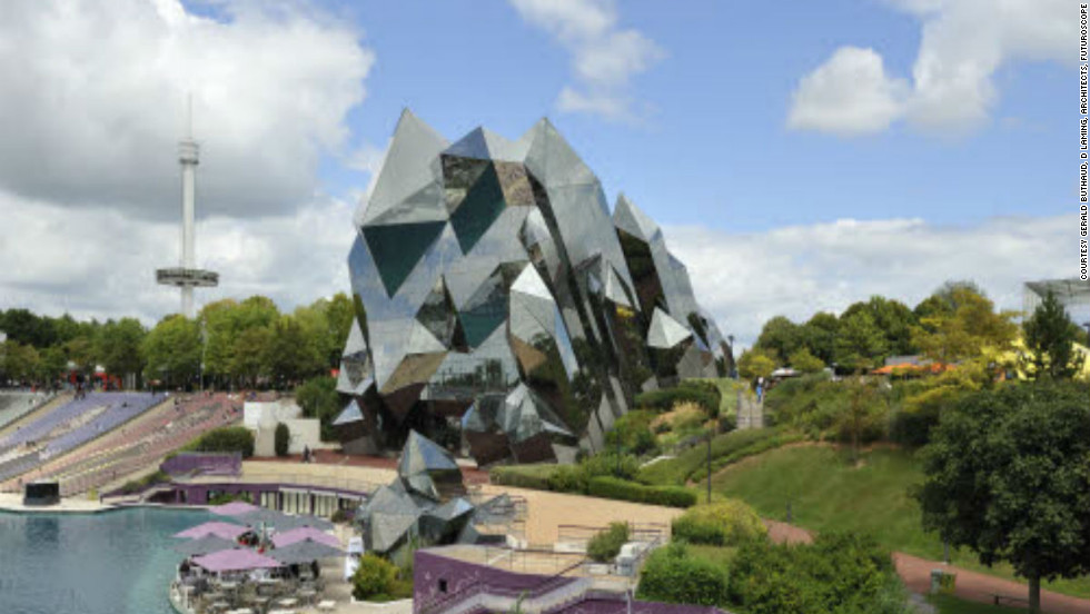"Symbolizing rock crystals thrusting out of the earth, this alluring building is one of the original pavilions created for the unique leisure park, <a href=""http://en.futuroscope.com/ "" target=""_blank"">Futuroscope</a>. <br /><br />It houses one of the park's many IMAX theaters -- with a screen measuring 6,458 square feet (the size of two tennis courts) and a 440-seat capacity. Great care was taken before the creation of this architectural marvel; a large-scale Plexiglas model was built using 3,000 plates -- thousands of hours were spent calculating its complex angles on computerized simulators. Even maintenance requires special skills. All window cleaners are required to be professional mountaineers.<br />(Image: Courtesy Gerald Buthaud, D Laming, Architects, Futuroscope)"