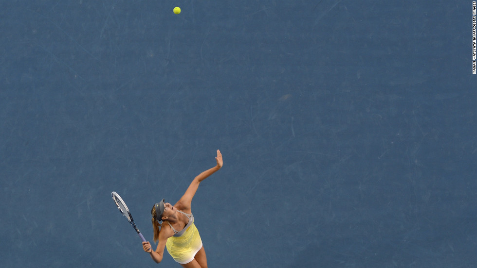 Sharapova serves against Williams during their women's singles match on January 18.