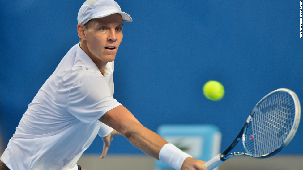 Berdych plays a return during his men's singles match against Melzer on January 18.