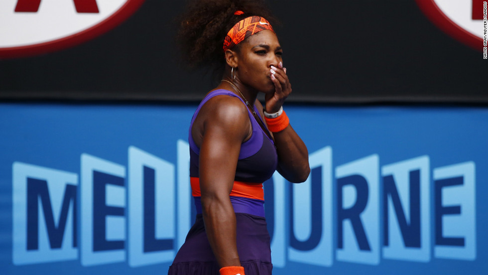 Serena Williams of the U.S. holds her mouth after hitting herself with her racket during her women's singles match against Garbine Muguruza Blanco of Spain during Day Four of the 2013 Australian Open on Thursday, January 17, in Melbourne, Australia. Williams won 6-2, 6-0.