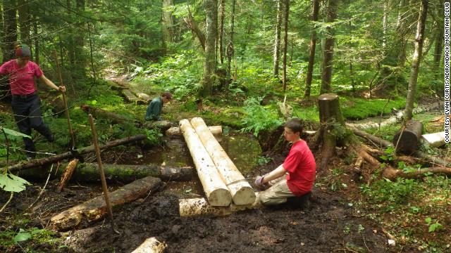 Adirondack Mountain Club teen trail volunteers build footbridges in the West Canada Lakes Wilderness Area in New York.