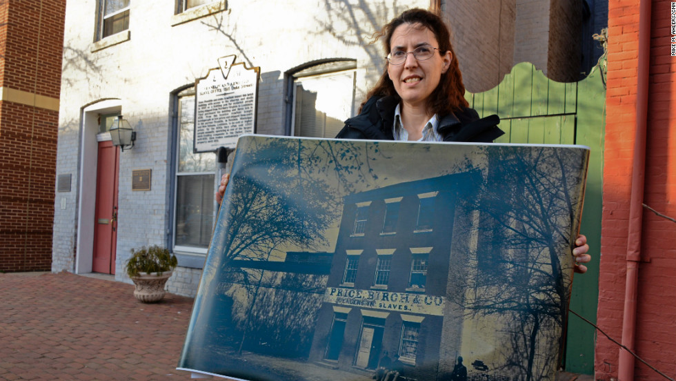 "Chandra Manning teaches 19th-century U.S. history at Georgetown University and wrote ""What This Cruel War Was Over: Soldiers, Slavery, and the Civil War."" Manning is standing in front of 1315 Duke Street in Alexandria, Virginia, a building once known as the ""Alexandria Slave Pen."""