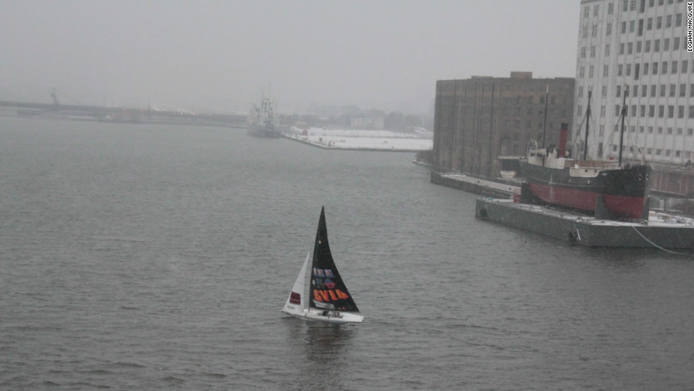 "A lonely sail adorned with the work of British street-artist, Eine (a.k.a Ben Flynn), skips its way around London's Royal Victoria Dock, branded with the uncompromising slogan ""See No Evil."" Eine received a famous name-check in 2010 when British prime minister David Cameron gifted one of his paintings to U.S. president Barack Obama while on a state visit."