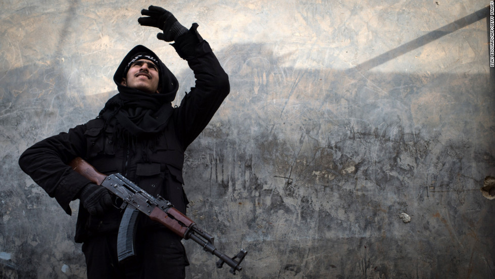 A Syrian rebel fighter tries to locate a government jet fighter in Aleppo on January 18.
