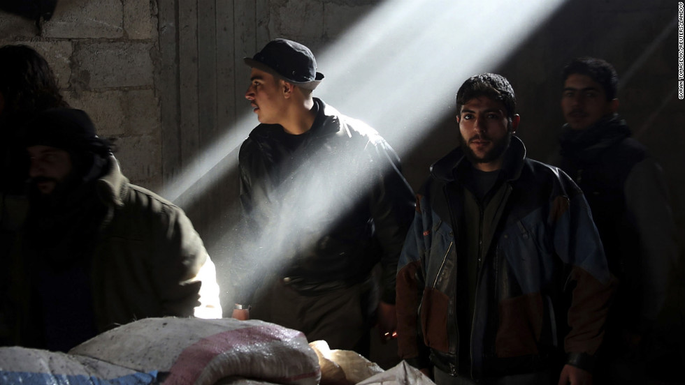 Rebel fighters stand in a house at a frontline in the Arabeen neighborhood of Damascus on January 19.