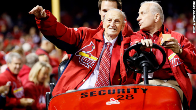 Stan Musial waves to fans during the 2012 National League Championship Series.