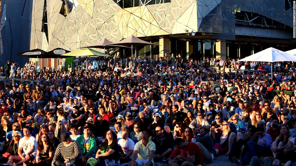 Huge crowds gather at Federation Square to watch Bernard Tomic of Australia play Roger Federer of Switzerland on Saturday, January 19. Federer won 6-4, 7-6 (5), 6-1.