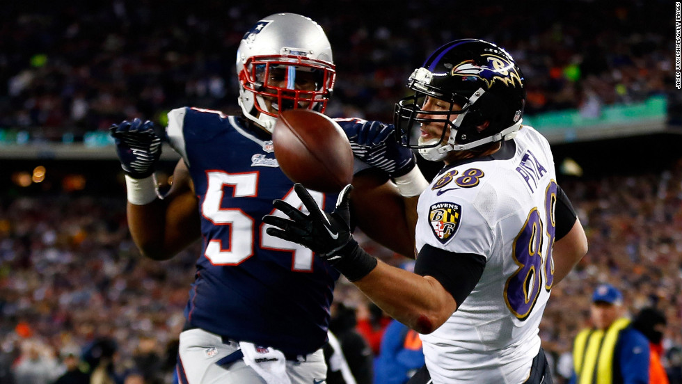Dennis Pitta of the Baltimore Ravens fails to catch a pass in the end zone against Dont'a Hightower of the New England Patriots during the AFC Championship game at Gillette Stadium in Foxboro, Massachusetts, on Sunday, January 20.