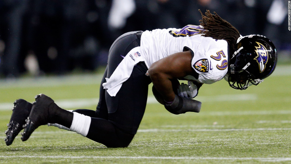Dannell Ellerbe of the Baltimore Ravens intercepts a pass by Patriots quarterback Tom Brady.
