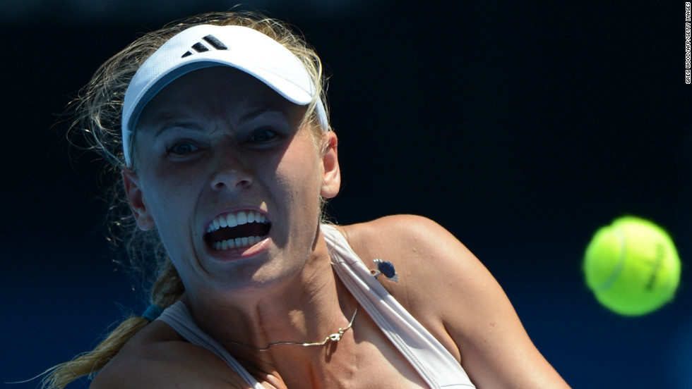 Caroline Wozniacki hits a return against Svetlana Kuznetsova on January 21.