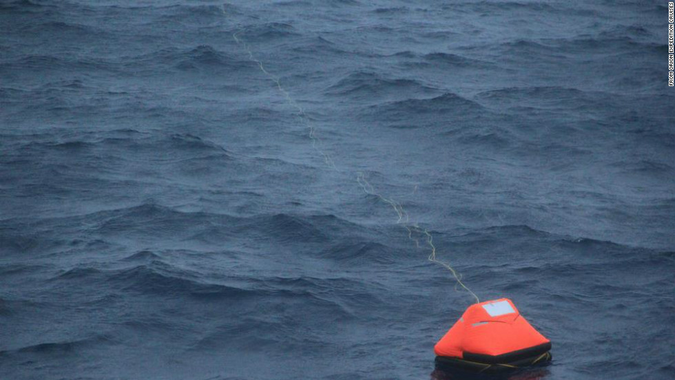 Alain Delord's life raft is pictured adrift in seas south of Australia and shortly before his rescue by the cruise ship Orion